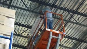 Belco Electrician installing T5 HO Fixtures