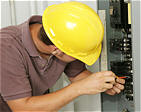 Qualified Electrician Inspecting Electrical Panel